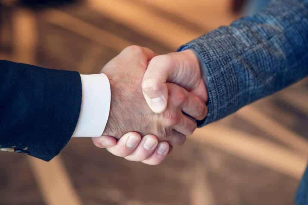 Men shake hands at business meeting