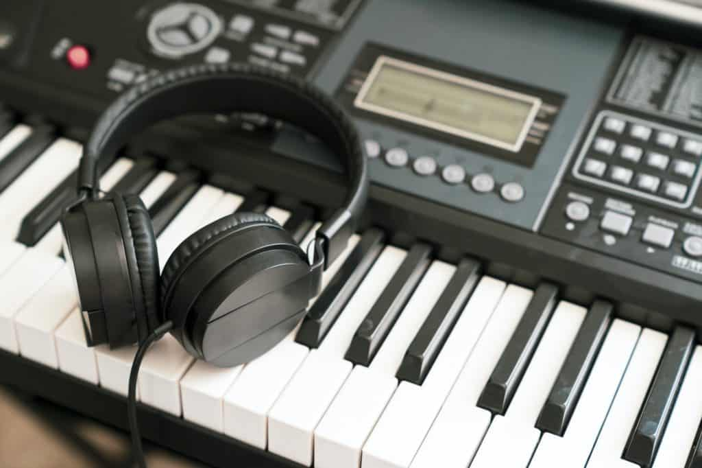 Headphones on musical synthesizer keyboard